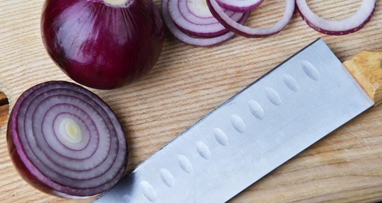 How do you cut onions with a Santoku Knife?